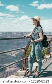 full length of travel lens man sightseeing the beautiful desert on grand canyon national park. Young girl love wild life travel freedom. photographer tourist hobby photographing by slr camera.