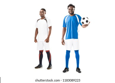 full length view of athletic young african american sportsmen standing with soccer ball isolated on white