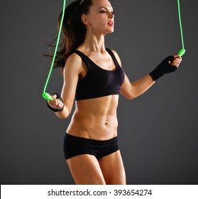 Full length view of an attractive woman with jumping rope