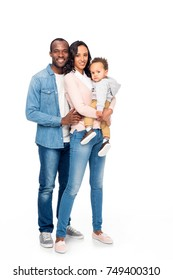 full length view of happy african american family with one kid smiling at camera isolated on white