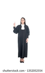 Full length view of judge in judicial robe showing idea gesture isolated on white