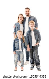 full length view of smiling family in jeans embracing and holding hands isolated on white