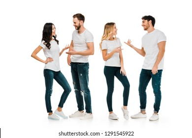full length view of young couples standing and talking isolated on white