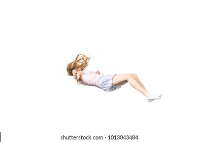 full length view of young woman falling isolated on white