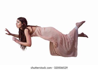 Full length of woman levitating against white background