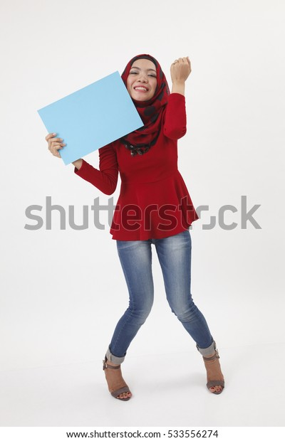 full length of the woman with tudung holding card