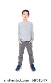 Full length of young asian boy standing over white background with copy space