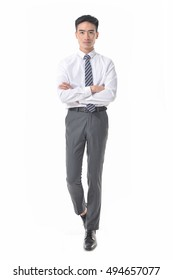 Full length of a young asian businessman with arms folded