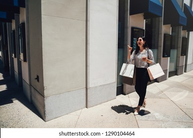 a33295c1dfe full length of young asian woman walking with shopping bags outside jewelry  store in stanford mall