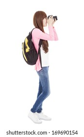 full length young girl taking a picture using digital camera