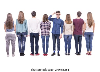 Full length. Young group standing with his back to the camera except one guy. isolated on white background.