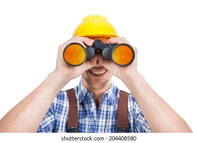 Full length of young male repairman looking through binoculars over white background