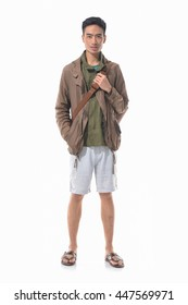 Full length young man with bag standing on white background