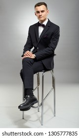 Full length of a young man in business suit