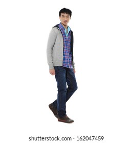 Full length Young man in jeans walking in studio