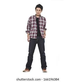 Full length Young man standing in jeans on white background