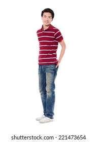 Full length young man standing in jeans posing with his hands on his pockets