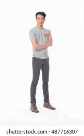 Full length young man standing in jeans posing on white background