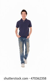 Full length young man walking in studio