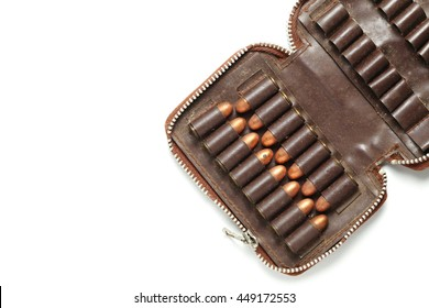 The full load of old and dirty spare pistol bullet put in the socket of pocket represent the weapon and bullet concept related idea.