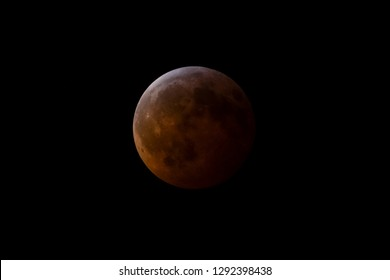 A full lunar eclipse turns the moon a warm red color.