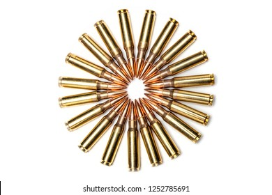 Full metal clad .303 caliber bullets for a gun arranged in a circle and isolated on a white background