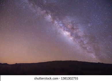 full milky way panorama over natural landscape