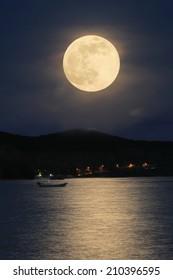 The Full Moon beautiful on Romantic tropical beach .