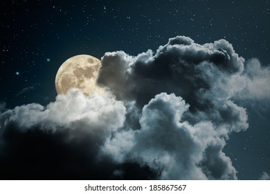 Full moon behind the clouds on a starry night