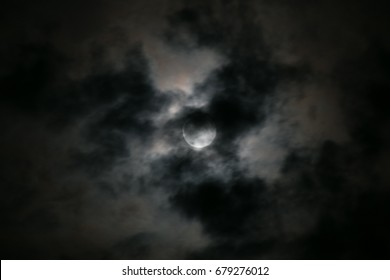 full moon with bright clouds and the moon as spotlight in a dark night sky in bavaria