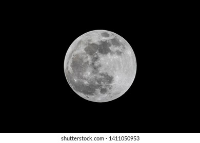 The full moon is captured against a night sky.