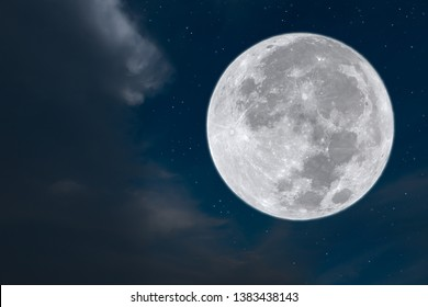 Full moon with cloud and stars on night.