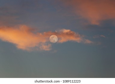 Full moon and clouds at sunset