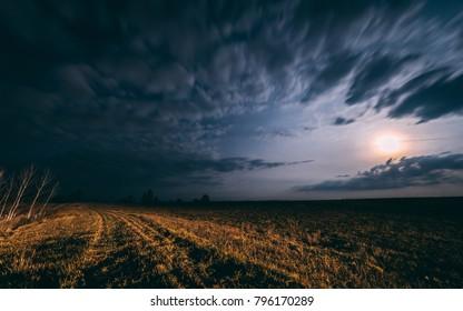 Full moon cloudy night.