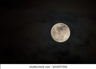 Full Moon in Cloudy Sky