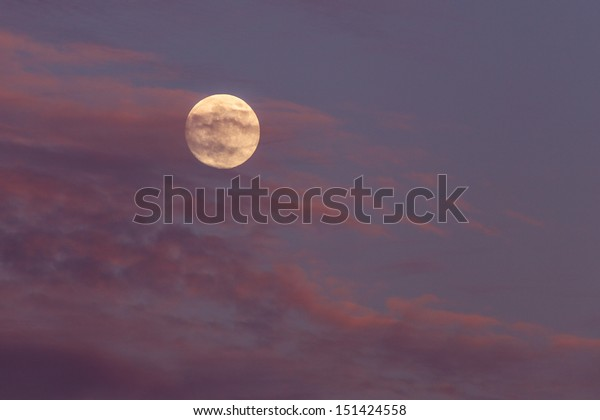Full moon and colorful clouds.