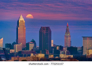 The full moon of December, a super moon, rises through clouds above downtown Cleveland, Ohio