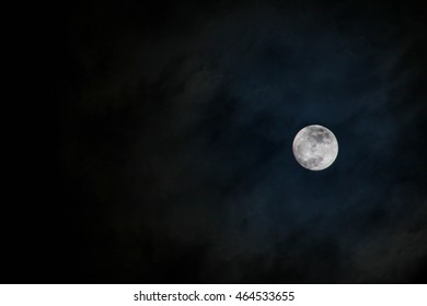 A full moon with eerie blue glow around it.