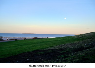Full moon in February. Cramond beach. Scottish nature. North sea skyline. Background for an inspirational text.