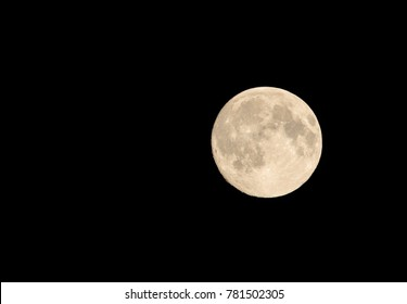 full moon isolated with black background and beautiful white with clear structures on the moon, big full moon in the foreground, background is without structures, full moon is sharp and has structures
