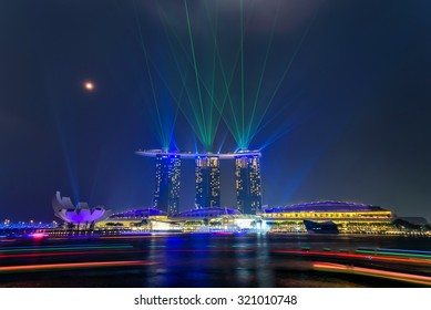 Full moon and lighting show over Singapore skylines. Mid-autumn is a big holiday in Asia with festival are held almost everywhere to celebrate with moon cake, lion dancing, lantern