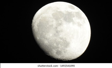 A full moon is the lunar phase that occurs when the Moon is completely illuminated as seen from Earth. Big moon in its full phase with detailed craters visible on its edges, all in a black background,