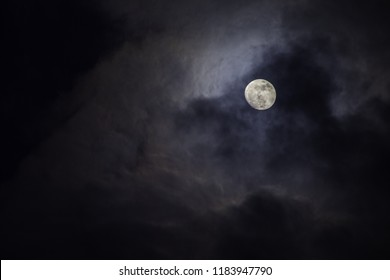 Full moon in the middle of clouds