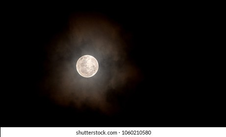 Full moon at night / The Moon is an astronomical body that orbits planet Earth, being Earth's only permanent natural satellite. It is the fifth-largest natural satellite in the Solar System