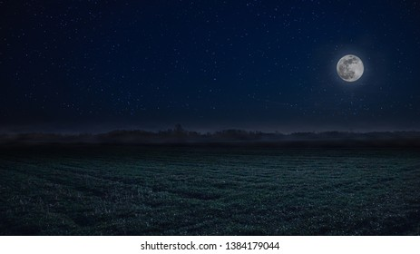Full moon night landscape with fog in the background. Supermoon with stars.