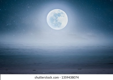 Full moon night in the middle of the sea beautifully