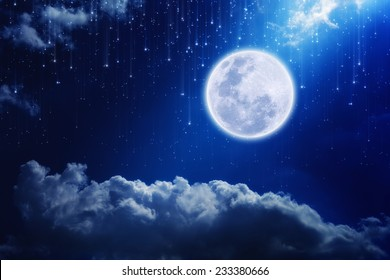 Full moon in night sky with falling stars and mysterious light from above. Elements of this image furnished by NASA