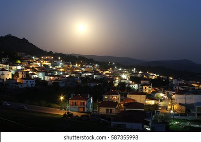 Full moon night view of the village of Mesotopos, in Lesvos island, northern Aegean Sea, Greece. The picturesque village is also known for its masons and its rich tradition in folk music.