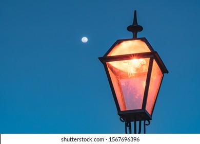 Full moon nightfall on a street lamp - Shutterstock ID 1567696396