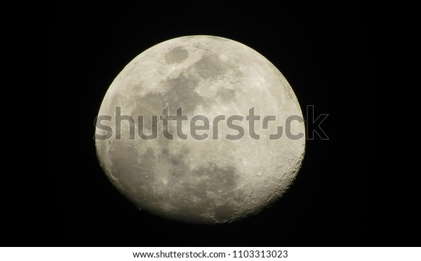 Full moon on the black background.